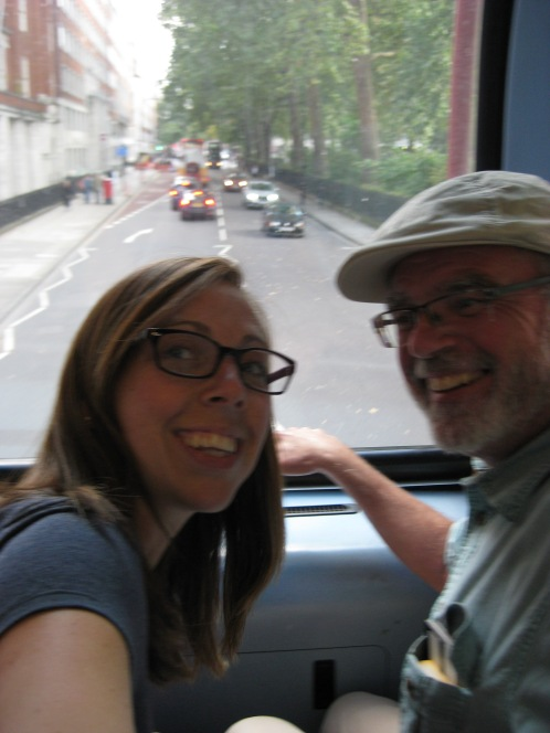 My dad and I on a double-decker bus in London.